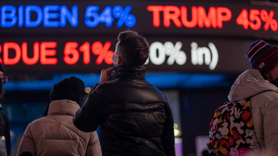 People gather in Times Square as they await election results on November 3, 2020 in New York City