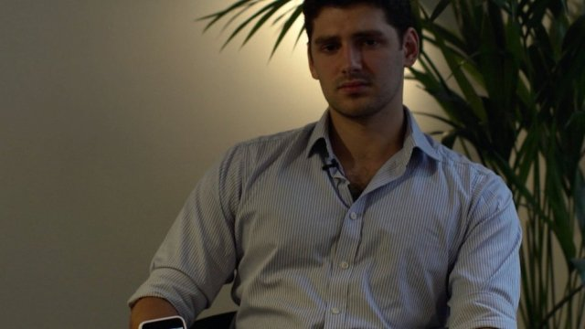 Sebastian Shemirani holding a phone