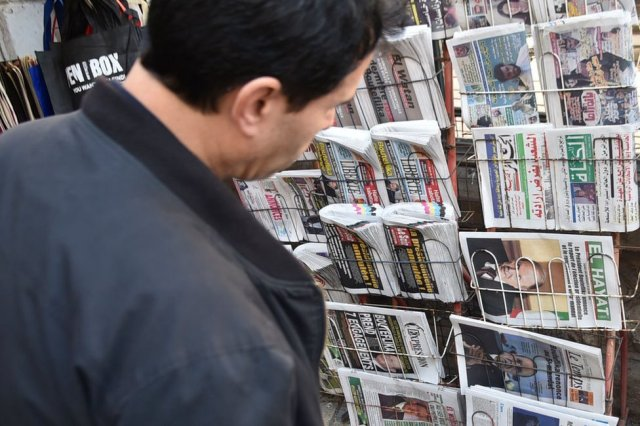 A man looks at newspaper front page on the day in March 2019 when then-President Abdelaziz Bouteflika announced he was no longer seeking a fifth term in office.