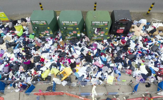 An aerial view of lots of rubbish discarded next to a recycling centre