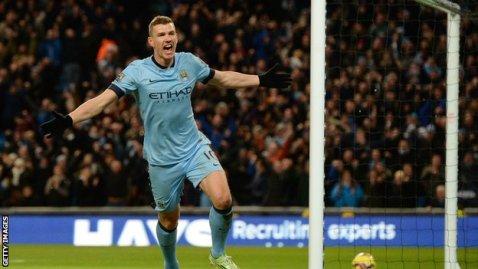 Manchester City striker Edin Dzeko celebrates scoring