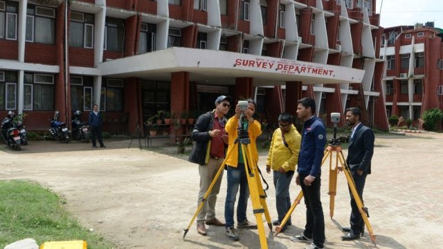 Nepali survey team check the equipments in Kathmandu before leaving on an expedition to re-measure the height of Everest