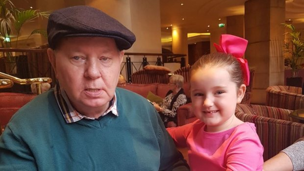 John Duffy with his granddaughter, celebrating his 70th birthday last year