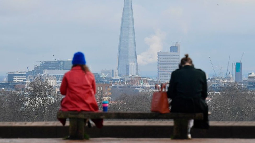 Two people keeping social distance in London, UK.