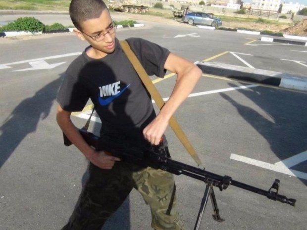 An image of Hashem Abedi from his father's Facebook page shows him brandishing a large gun