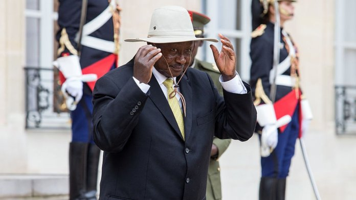 President Yoweri Museveni of Uganda wearing a hat on a visit to France