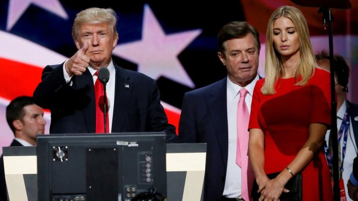 Donald Trump gives a thumbs up next to his campaign manager Paul Manafort and Ivanka Trump