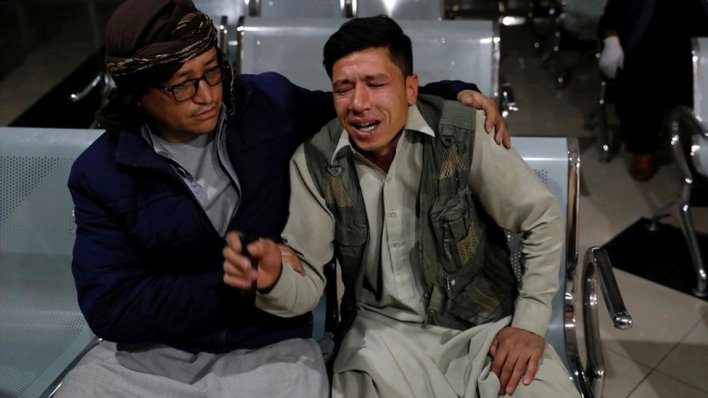 An Afghan man who lost his brother mourns at a hospital after a suicide bombing in Kabul, Afghanistan, 24 October 2020