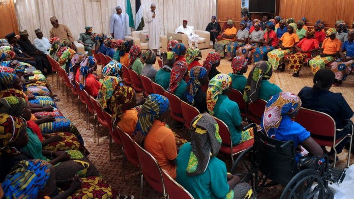 "Nigeria""s President Muhammadu Buhari (L) addresses the 82 rescued Chibok girls during a reception ceremony at the Presidential Villa in Abuja, on May 7, 2017."