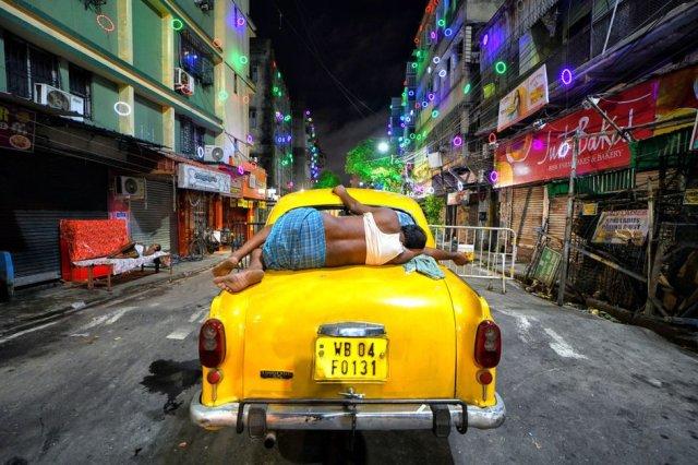 Taxi driver asleep in Kolkata
