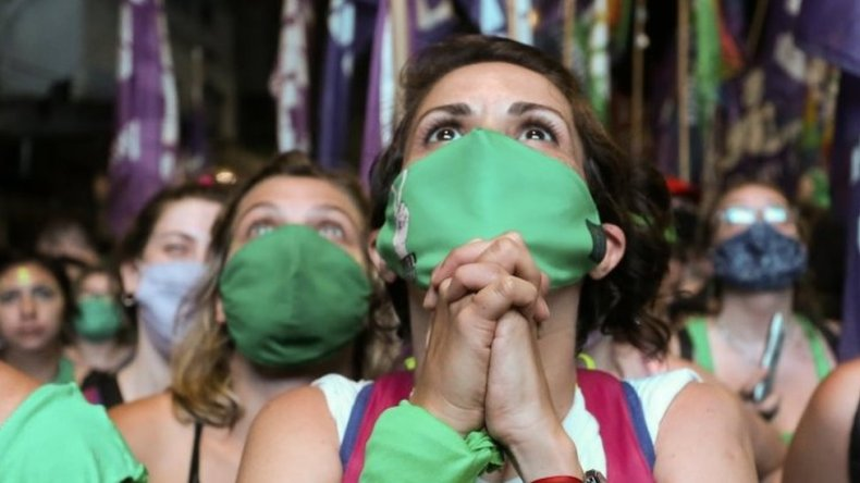 A demonstrator in favour of legalizing abortion reacts as the senate debates an abortion bill, in Buenos Aires, Argentina, December 30, 2020.
