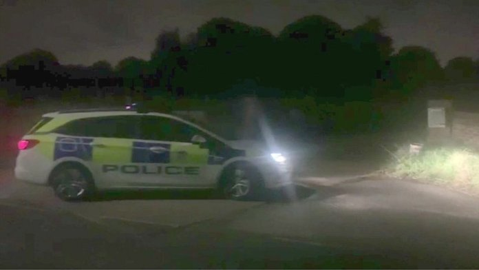 Police car marked outside a property on Park Road, Banstead