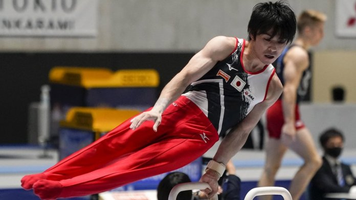Olympic champion Kohei Uchimura in action at an event in Tokyo seen as a crucial trial run for next year's postponed Olympics