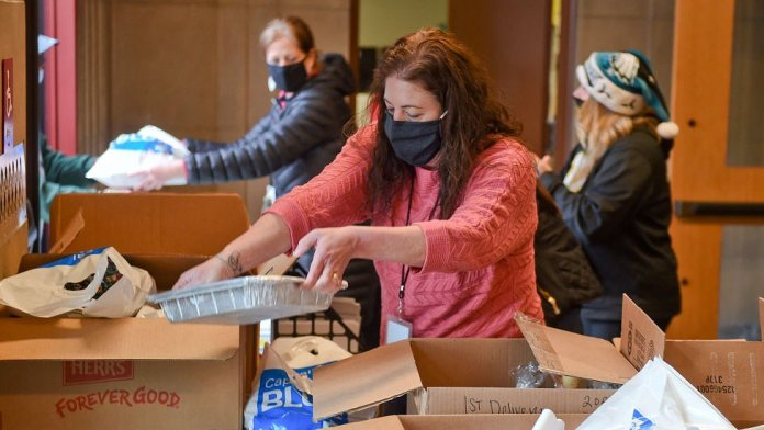 A Social Worker with the Reading School District, Pennsylvania, helps to pack up meals to be distributed on December 22, 2020