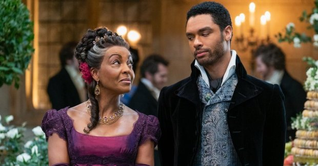 ADJOA ANDOH as LADY DANBURY and REGÉ-JEAN PAGE as SIMON BASSET