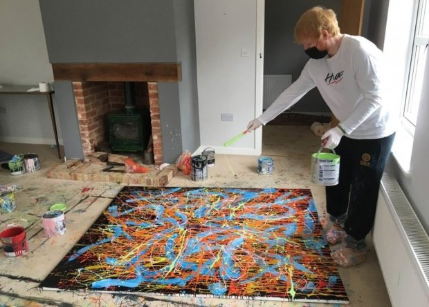 Ed Sheeran working on the painting Dab 2, which is up for auction for charity