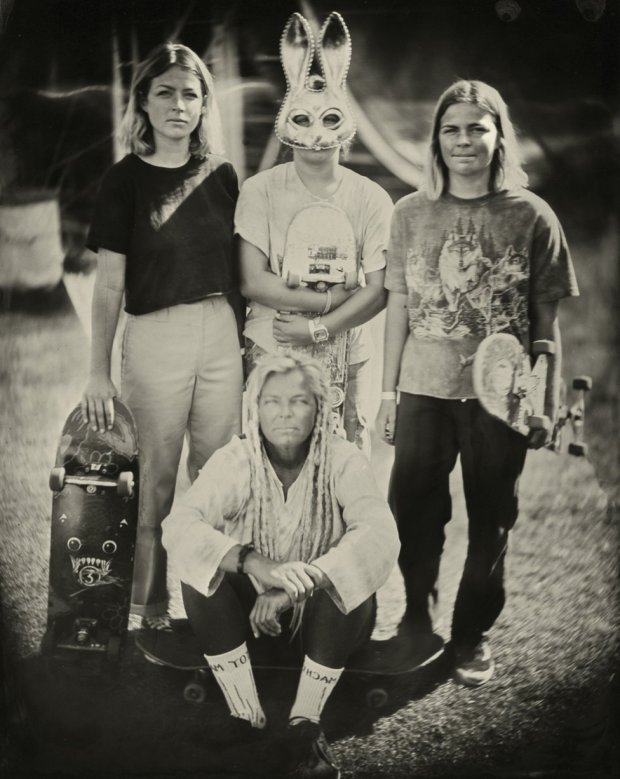 Portrait of a group of people with skateboards