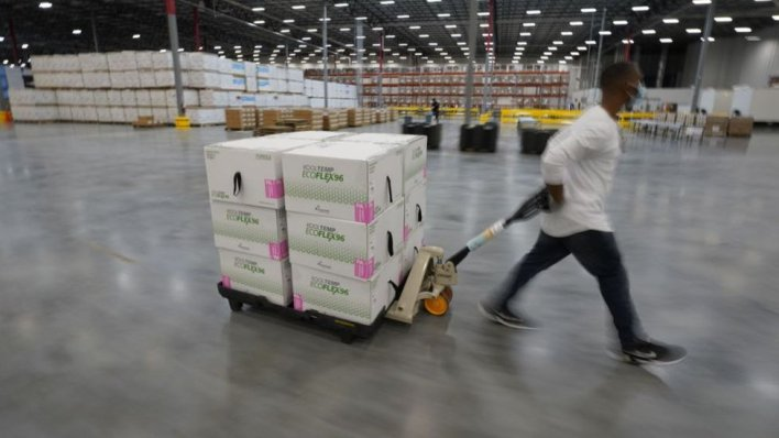 Boxes containing the Moderna COVID-19 vaccine are prepared to be shipped at a distribution center in Olive Branch, Mississippi, USA, December 2020