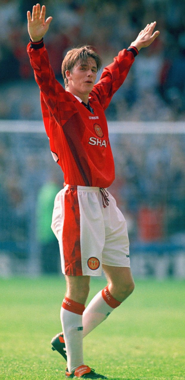 Manchester United player David Beckham celebrates after scoring the third goal against Wimbledon with a spectacular effort from the halfway line in 1996