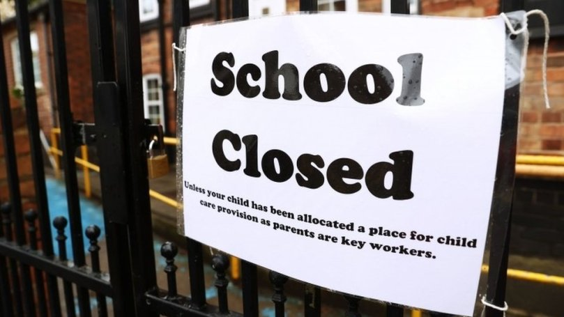 Sign on school gate saying 'School Closed'