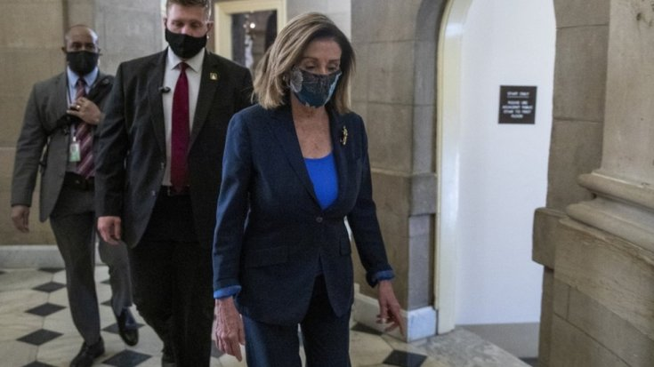 Speaker of the House Nancy Pelosi walks to her office from the House floor