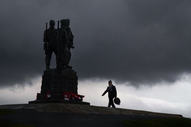 A member of the military lays a wreath at Commando Memorial to commemorate and pay respect to the sacrifice of service men and women who fought in the two World Wars and subsequent conflicts in Spean Bridge, Scotland, 8 November 2020.