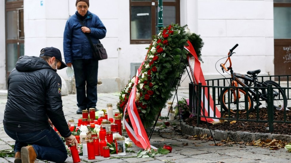 A mourner places a candle at the site of a gun attack in Vienna, Austria, November 4, 2020