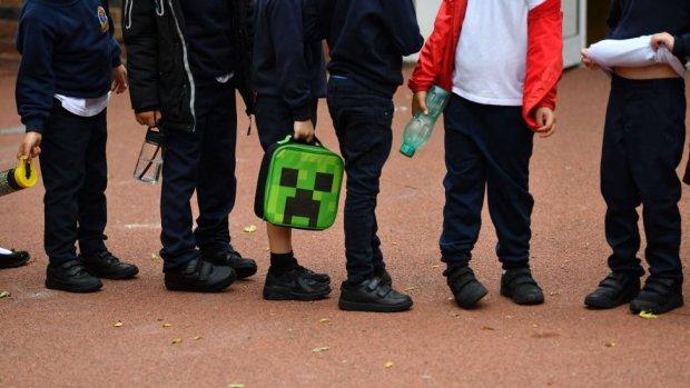 Children in a queue outside school