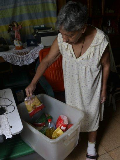 Norma Mujica shows food