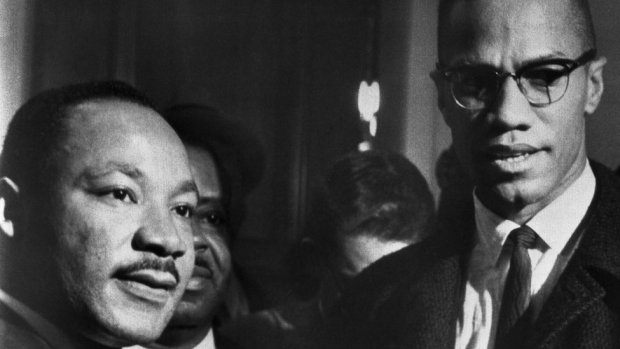 The brief, and only, meeting between Malcolm X (R) and Martin Luther King (L) in Washingon DC, 26 March 1964