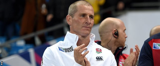 Stuart Lancaster applauds England's players off the field