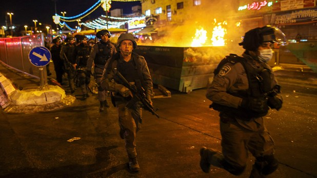 Israeli security forces clash with Palestinians outside the Damascus Gate
