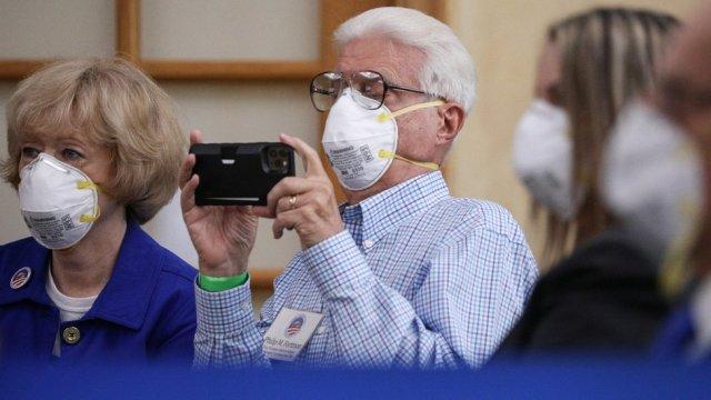 People watch Joe Biden speak in Florida