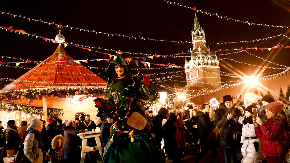 A woman wearing a costume at the illuminated street ahead of Christmas in Moscow