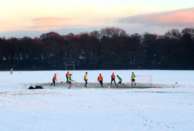 A football training session takes place on snow covered pitches on 29 December 2020 in Wimslow, England