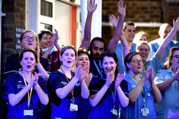 NHS staff applaud outside the Dorset County Hospital in Dorchester