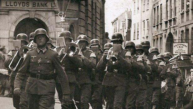 A German band marches through Guernsey's St Peter Port High Street