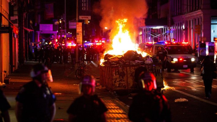 Protesters set fire to garbage in New York