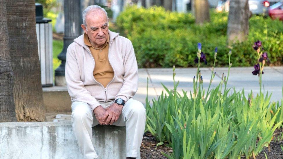 Older gentleman in a park