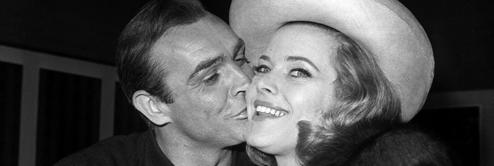 Honor Blackman (Pussy Galore) and Sir Sean Connery (James Bond) before filming of Goldfinger