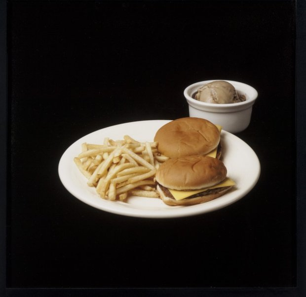 A meal featuring two burgers, french fries and ice cream