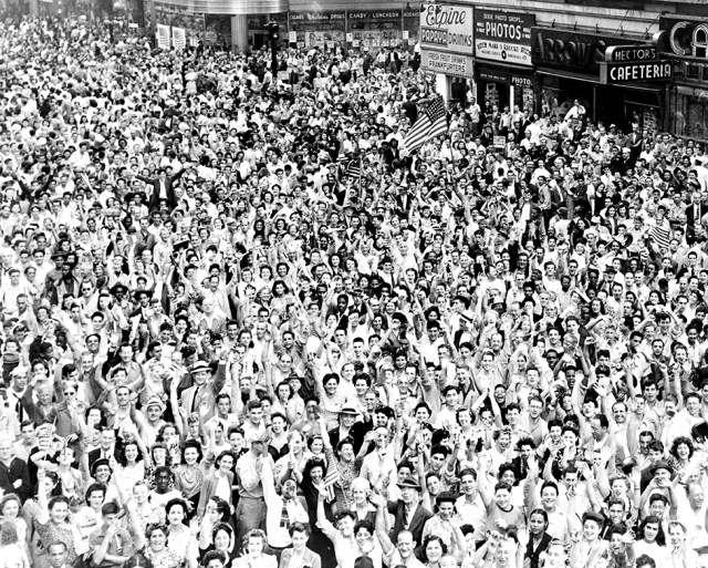 A crowd cheers in Times Square in New York