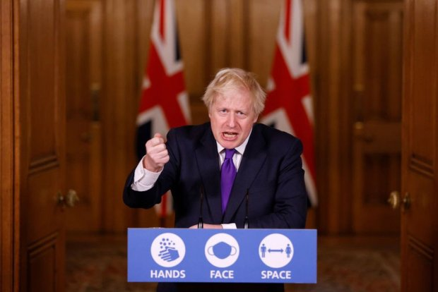 Prime Minister Boris Johnson speaks during a news conference on the ongoing situation with the coronavirus disease (COVID-19), at Downing Street on 2 December 2020 in London, England.