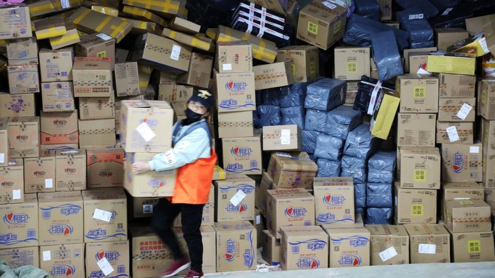 Staff sorting through parcels after Singles Day last year