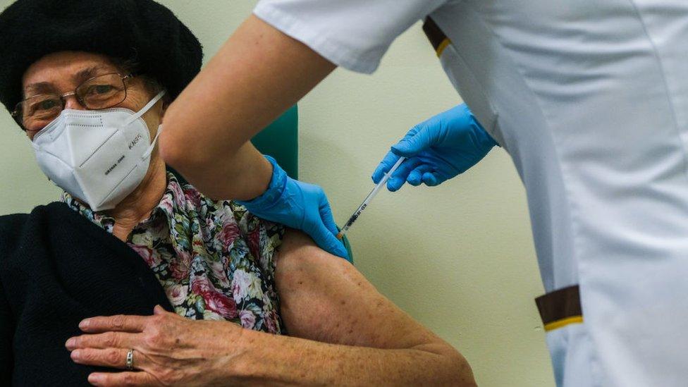 Patient receiving the Pfizer vaccine in the UK.