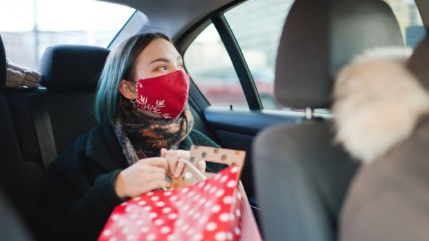 Woman in mask in car