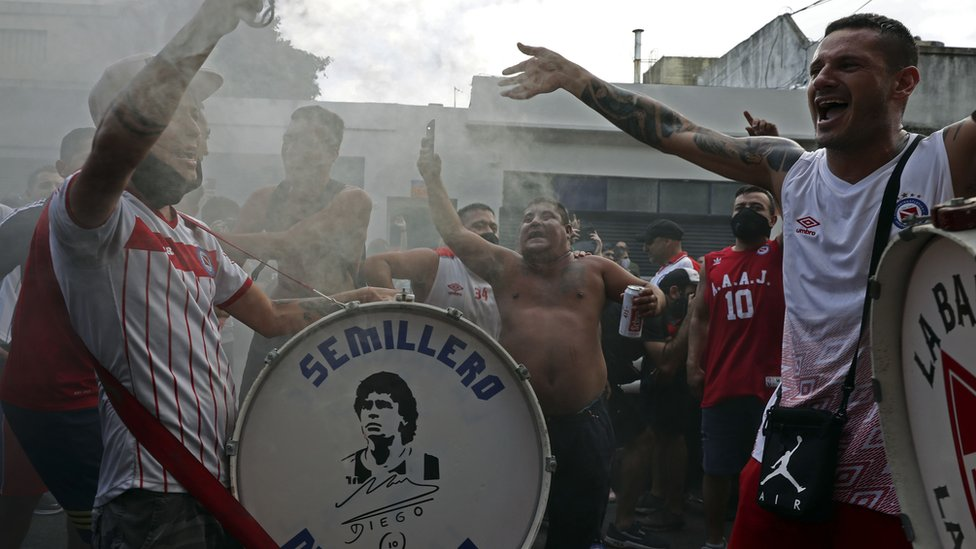 Fans of Argentinos Juniors' football team, where Argentinian football legend Diego Maradona used to play gather outside the stadium