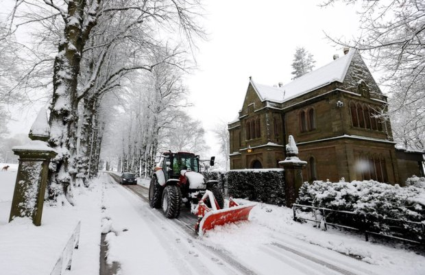 A snowplough clears a street in Keele, Staffordshire, Britain, 29 December 2020