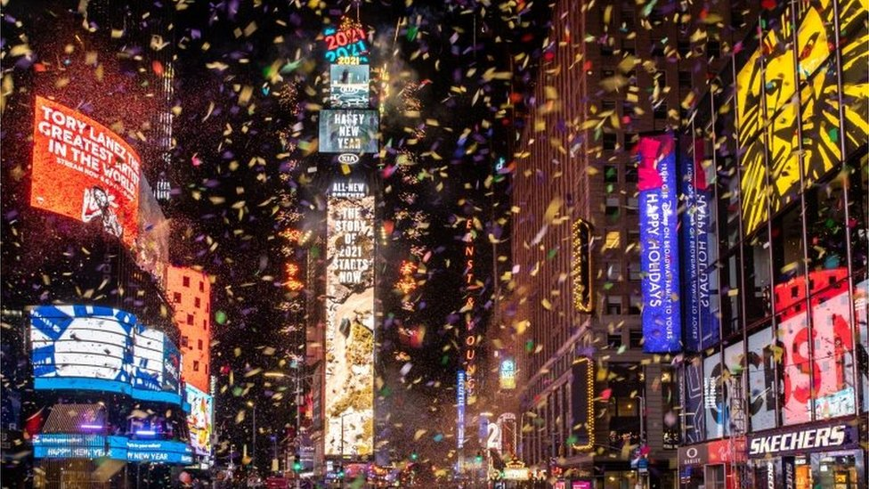 Confetti flies around in Times Square during the New Year celebrations