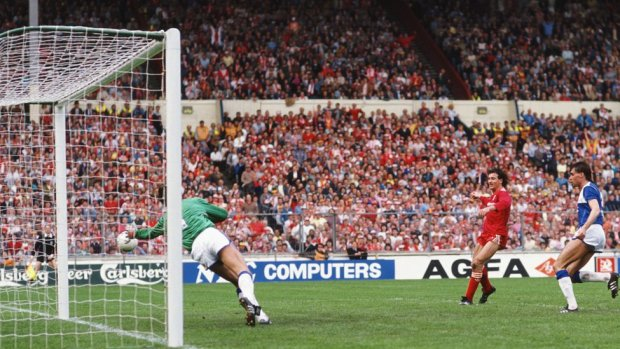 Everton defender Pat Van Den Hauwe looks on as Liverpool player Craig Johnston (c) scores the second goal past Everton goalkeeper Bobby Mimms during the 1986 FA Cup Final on May 10th, 1986